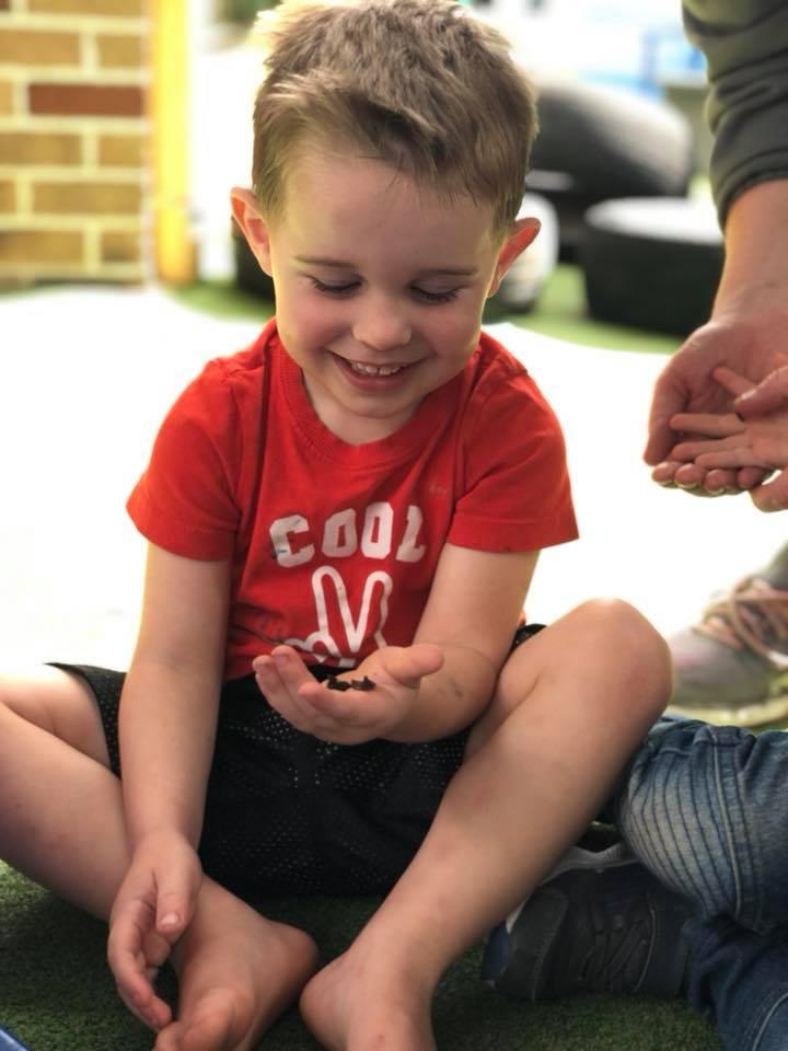 Boy holding worm
